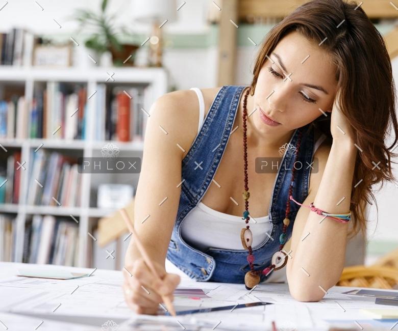 demo-attachment-137-young-pretty-woman-at-her-desk-PDDLFRL